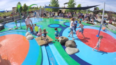 Splash park playground in urban area in the Summer. Stock Footage