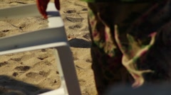 Workers walking on the hot sand Stock Footage