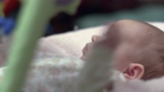 Newborn Looking At Colorful Baby Toy 02 - stock footage