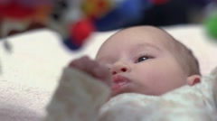 Newborn Looking At Colorful Baby Toy 05 - stock footage
