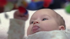 Newborn Looking At Colorful Baby Toy 06 - stock footage
