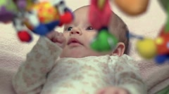 Newborn Looking At Colorful Baby Toy 08 - stock footage