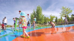 Splash park playground in urban area in the Summer. Stock Footage