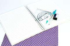 Empty white paper notebook with ruler, protractor, angle, triangle, square on - stock photo
