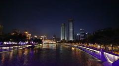 Night view of Anshun Bridge above Jinjiang river, and downtown of Jiuyanqiao Stock Footage