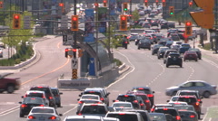 Severe summer heat waves rising from the pavement with traffic in city Stock Footage