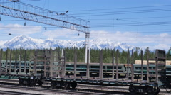 Railway station, freight cars, mountains, clouds, timelapse Stock Footage