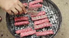 Minced meat kebabs on barbecue - stock footage