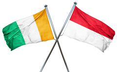 Ivory coast flag with Indonesia flag, 3D rendering Stock Illustration