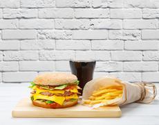 Fast food take away. Hamburger, cola and fries Stock Photos