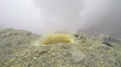 Eruption of gas and steam from sulfur fumarole in crater of active volcano - stock footage