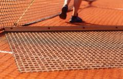 Aligning surface tennis court, with pulling network - stock photo