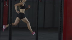 Slow Motion Tracking Shot Of Blonde In Athletic Gear Doing Wind Sprints Stock Footage