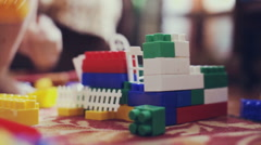 Kids playing constructor. Children playing with colorful plastic blocks. Stock Footage