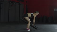 Woman exercising with weight bar in gym, aerobics Stock Footage