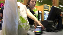 Attractive female pet store worker taking receipt for customer - stock footage