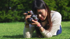 My beautiful Asian friend photogrpaher clicking some flowers Stock Footage