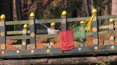 Bridge with prayer flags  Nest Monastery near Paro, Bhutan. Stock Footage