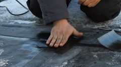 The Builder conceals the roof EPDM membrane. PVC-P AND TPO FPO - stock footage