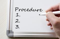 Procedure written on whiteboard - stock photo