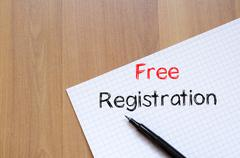 Free registration write on notebook - stock photo