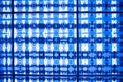 Abstract blue tone stained mosaic pixel texture wallpaper background Stock Photos