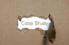 The word case study appearing behind torn paper. - stock photo
