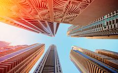 Dubai, UAE - November 30, 2013: Skyscrapers on a background of the sky in Dub Stock Photos