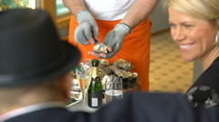 Chef opens fresh oysters for customers in the restaurant. - stock footage