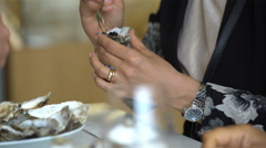 Woman eating fresh oysters at the restaurant. - stock footage