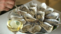 Oysters and champagne in a restaurant. - stock footage