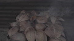 Coconut shell on fire - stock footage