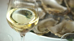 Oysters and glass of champagne in a restaurant. - stock footage