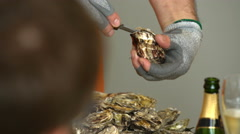 Chef opens oysters for visitors to the restaurant. Stock Footage