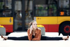 Acrobat using the phone in the city Stock Photos