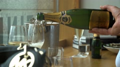 The waiter pours champagne to visitors of the restaurant. Stock Footage