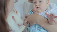 Mother with father shows white rabbit for her son Stock Footage