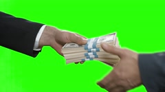Male hands pass dollar bundles. Stock Footage