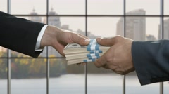 Hands pass money and key. - stock footage