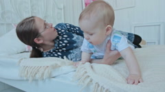 Mother and baby boy lying on the bed Stock Footage