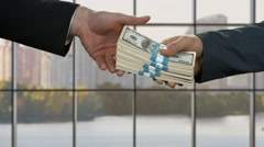 Male hands pass money. - stock footage