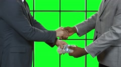 Men with dollars shaking hands. Stock Footage