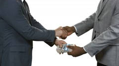 Businessmen with cash shaking hands. Stock Footage