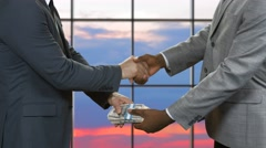 Handshake of men with dollars. Stock Footage