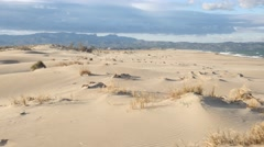 4k Sandstorm desert sand dunes beautiful arid scenic african landscape heat sun Stock Footage