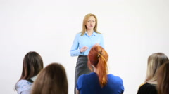 Beautiful business woman is speaking on conference. - stock footage