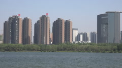 Shenyang Cityscape China, zoom out over the Hun River Stock Footage