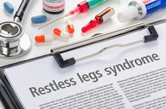 The diagnosis Restless legs syndrome written on a clipboard - stock photo