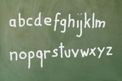 the alphabet written on a blackboard - stock photo