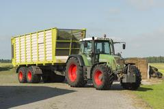 Transport of cut grass with tractor and loader wagon Stock Photos